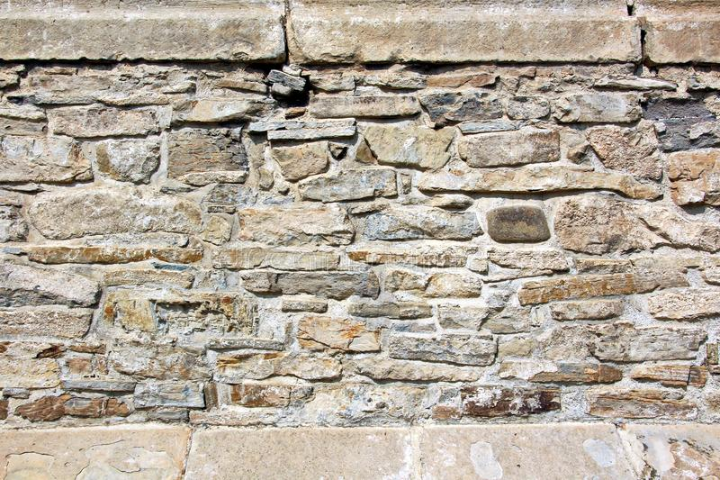 Various background types of laying stones from granite and other materials used in the construction. Of old buildings and structures stock photo