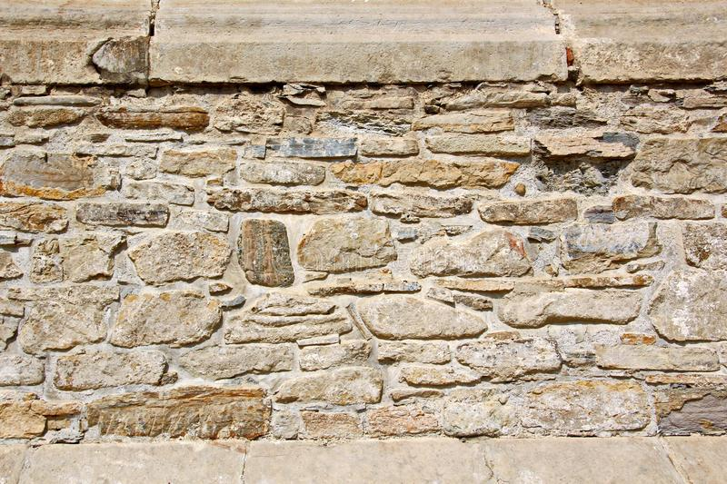 Various background types of laying stones from granite and other materials used in the construction. Of old buildings and structures stock image