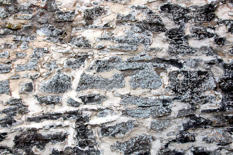 Various background types of laying stones from granite and other materials used in the construction. Of old buildings and structures stock photos