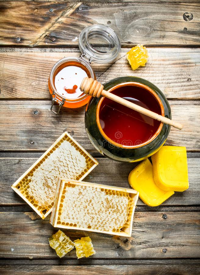 Various bee honey. On a wooden background royalty free stock photography