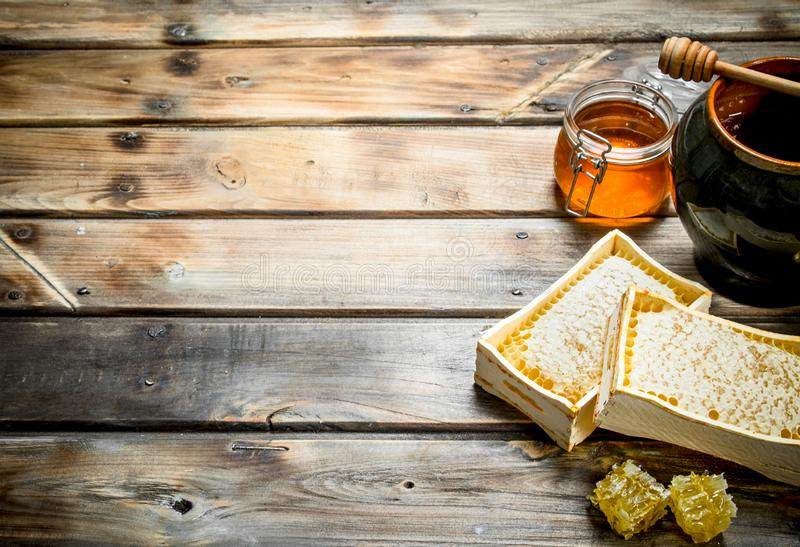 Various bee honey. On a wooden background royalty free stock photo