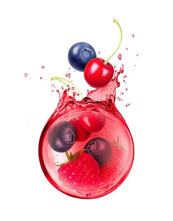 Various berries are drowned in a spray of juice royalty free stock photos