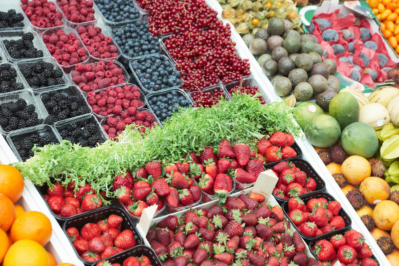 Various berries on market stall stock photo