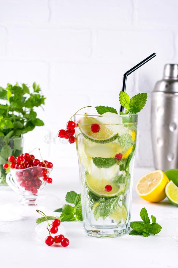 Various berry lemonade or mojito cocktails, fresh iced lemon lime , Red currant infused water, summer healthy detox drinks stock photos