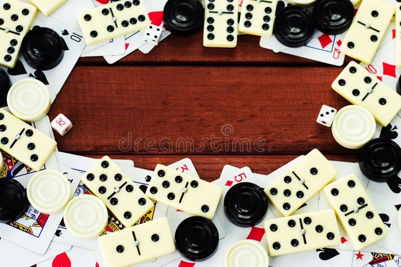 Various board games chess board, playing cards, dominoes. stock photos