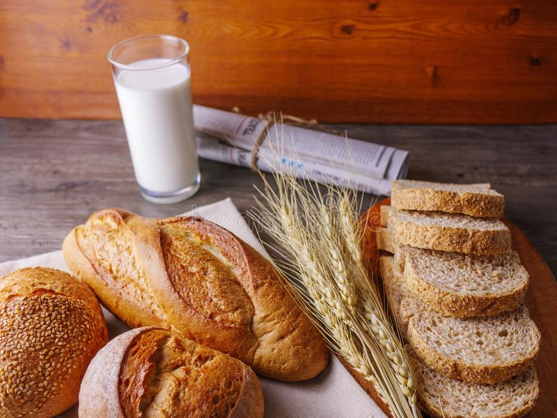 Various breads with milk and news paper royalty free stock photos