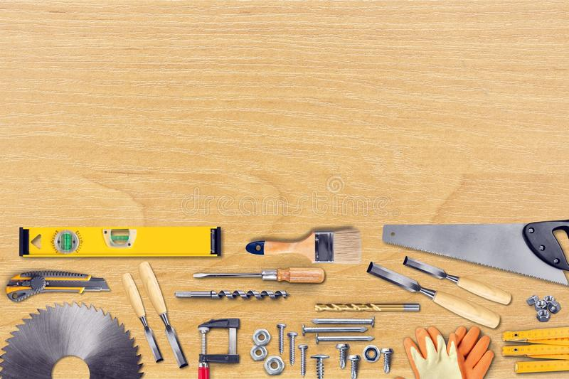 Various Building tools isolated on wooden royalty free stock images