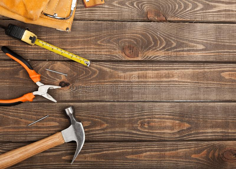 Various Building tools isolated on wooden royalty free stock image