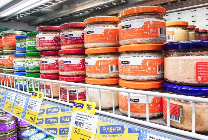 Various canned fish caviar in cans for sale on the shelves royalty free stock photography