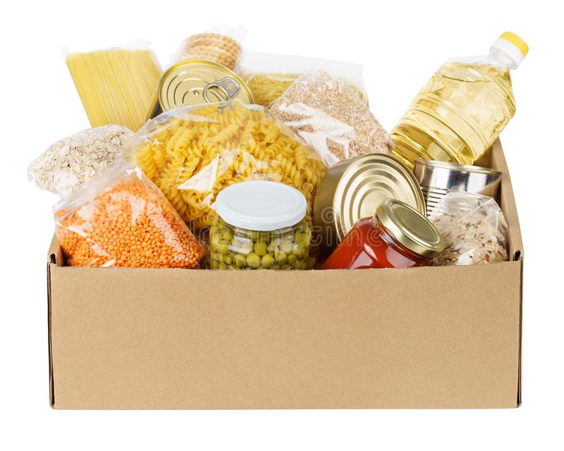 Various canned food, pasta and cereals in a cardboard box royalty free stock photos