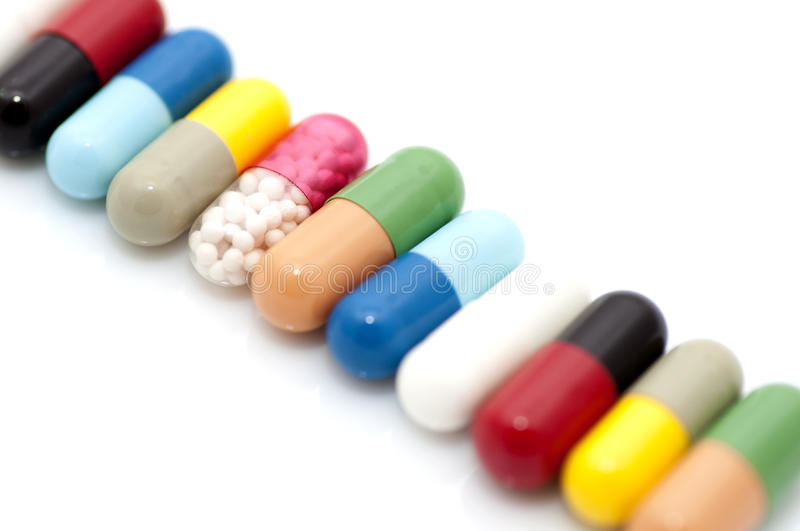 Various capsules in row royalty free stock image