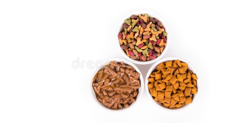 Various cat food. Dry and wet cat food. Copy space. Treats for cats stock images