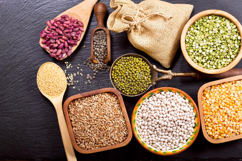 Various cereals, seeds, beans and grains royalty free stock photo
