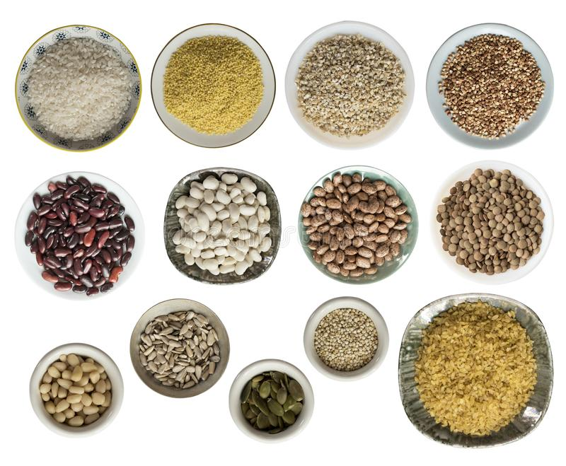 Various cereals, seeds, beans, peas on plates isolated on white background, top view. royalty free stock photo