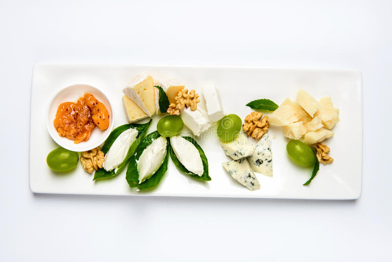 Various cheese type dish served luxery, isolated. Various cheese type dish served luxery. Top view, white background, isolated royalty free stock image