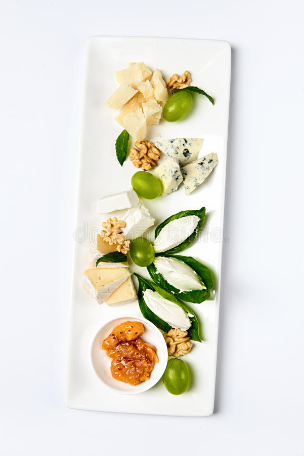 Various cheese type dish served luxery, isolated. Various cheese type dish served luxery. Top view, white background, isolated stock image