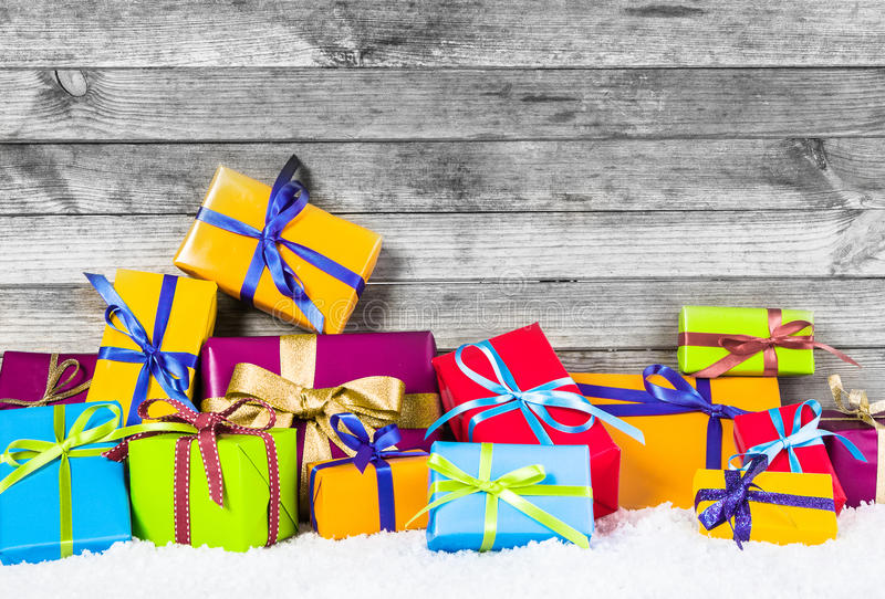 Various Christmas Presents in Different Colors. Close up Various Christmas Presents in Different Colors for Winter Holiday Season. Captured with Vintage Wood royalty free stock images