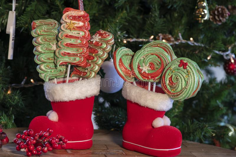 Various Christmas sweets and candies with christmas tree on wood table royalty free stock photo
