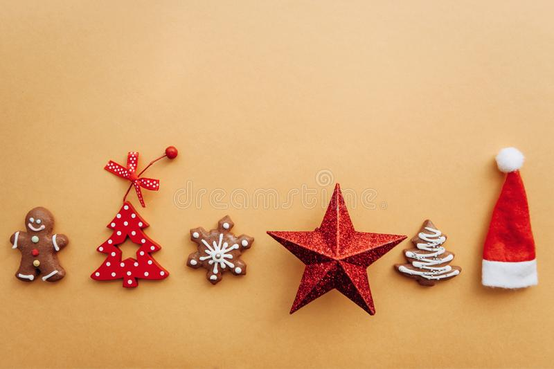 Various Christmas toys, decorations and food including gingerbread cookies on a yellow background. royalty free stock image