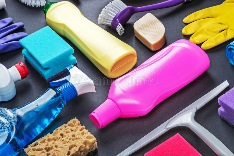 Various cleaning products for the house on a colored stock photos