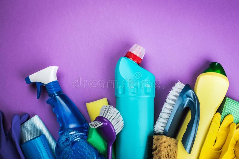 Various cleaning products for the house on a colored stock photo