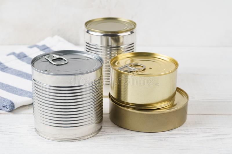Various closed tin cans with food preserves royalty free stock image