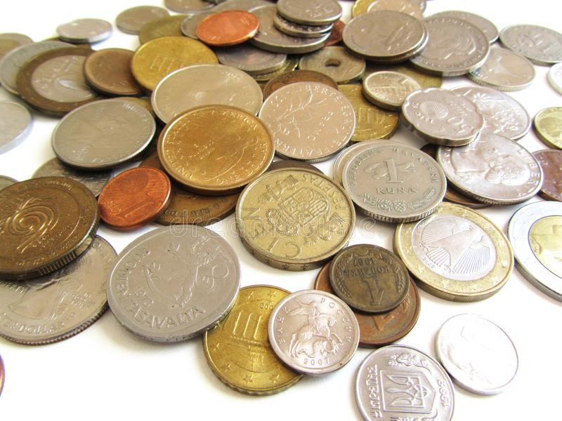 Various coins from different countries stock photography
