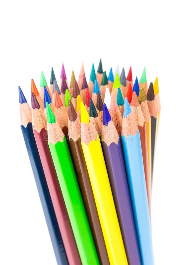 Various colered crayons standing upright stock images