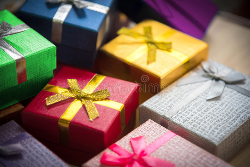 Various color of christmas&happy new year gift boxes stack, reward holiday presents greeting celebration card concept. Background, selective focus, 45 degree royalty free stock photography