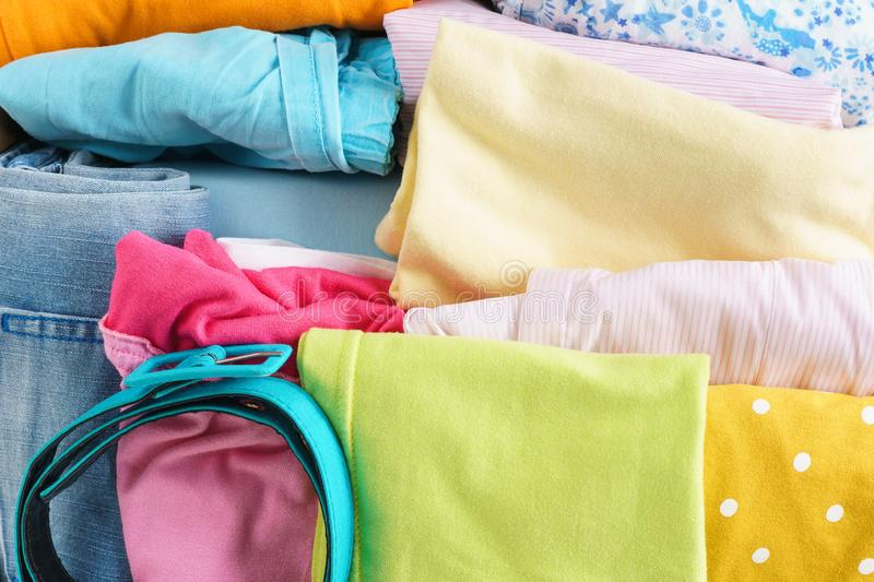 Various colorful clothes for children and teenagers royalty free stock image