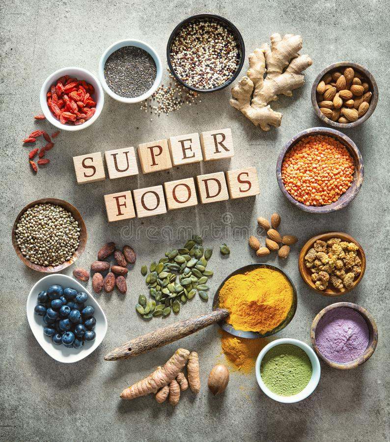 Various colorful superfoods in bowls royalty free stock photos