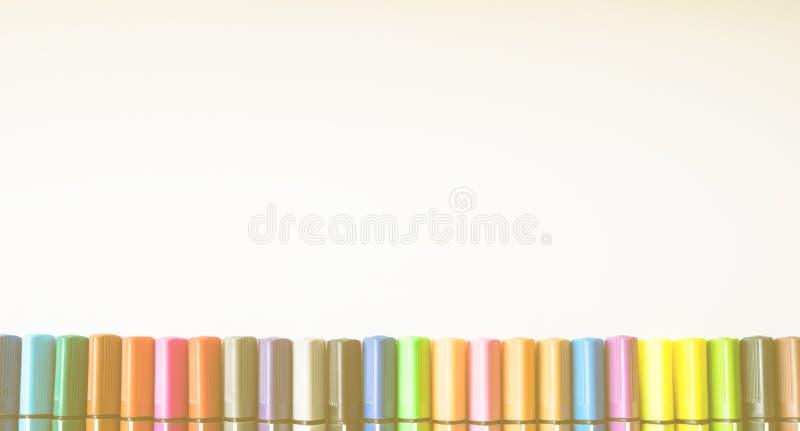 Various colour pens. On white background stock image