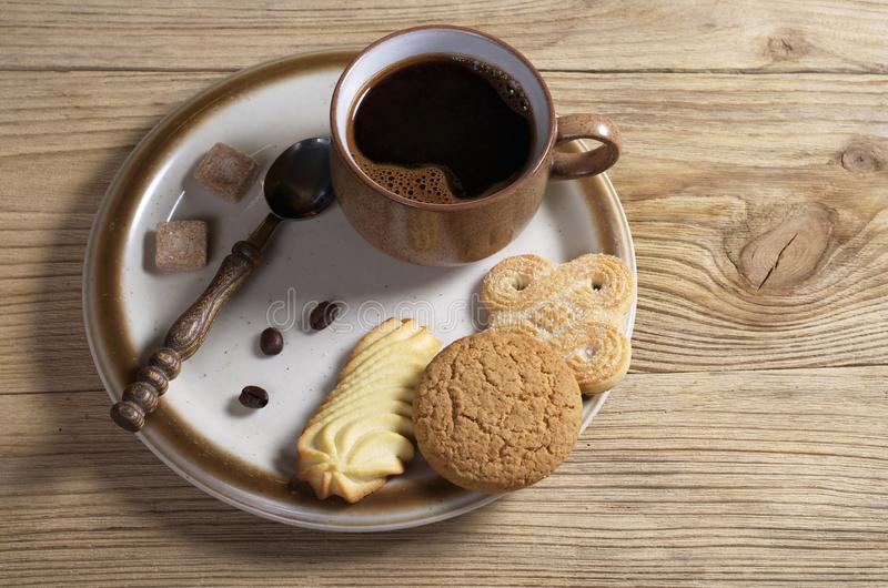 Various cookies and coffee in plate stock photos
