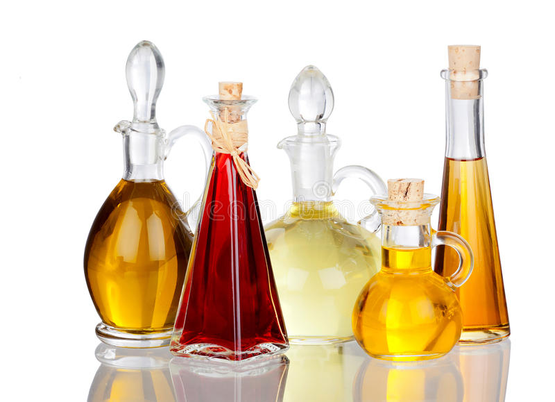 Various Cooking Oils in Glass carafes with real reflection stock photos