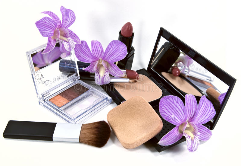 Various Cosmetic. Women's cosmetic shot with orchids royalty free stock image