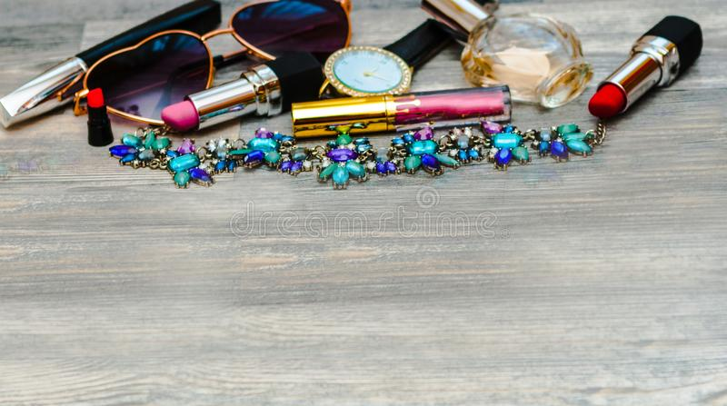 Various cosmetics, accessories and bouquet of tulips on stock photos