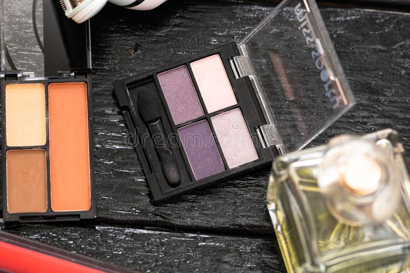 Various cosmetics on a black background. Beauty products, close up photo. Bucharest, Romania, 2019.  royalty free stock photo