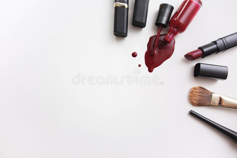 Various cosmetics on white background. On one side spase for text royalty free stock photography