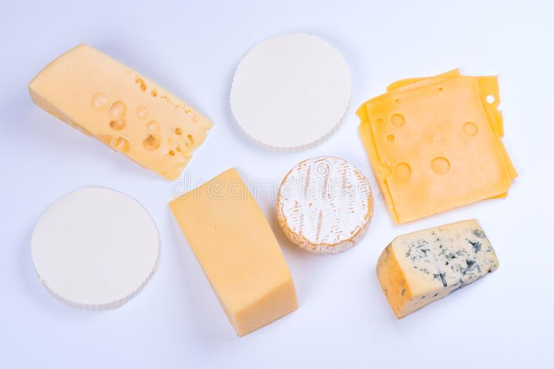 Various dairy cheese on a white background royalty free stock photos