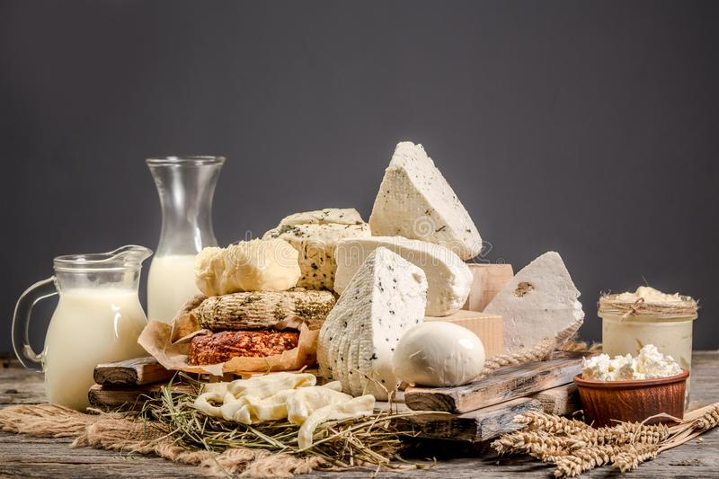Various dairy products. Assortment of cheeses. Free space for text stock images