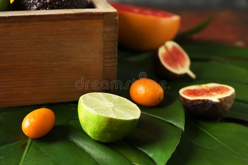 Various delicious exotic fruits on tropical leaves royalty free stock images