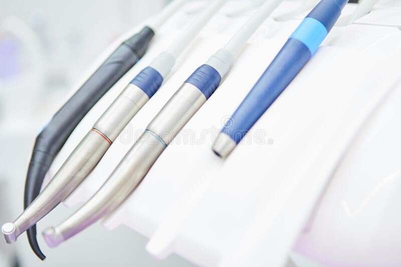 Various dentist instruments in dental office royalty free stock images