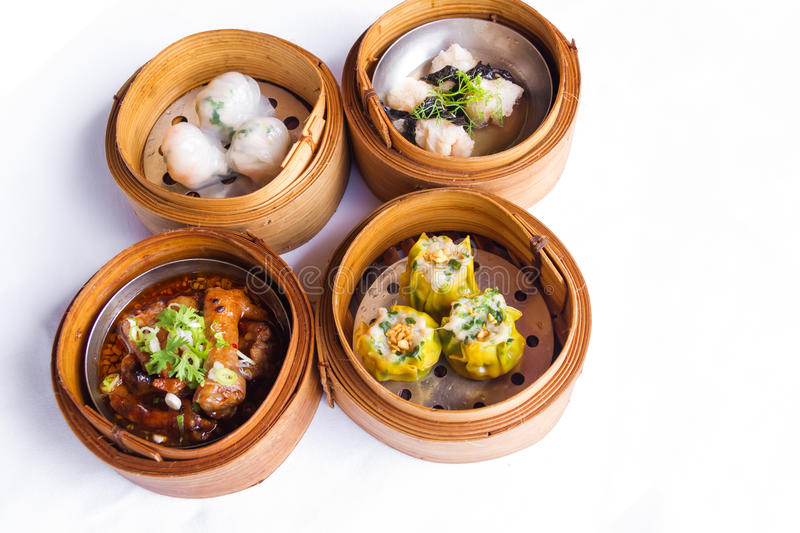 Various dim sum in bamboo steamed bowl stock photos