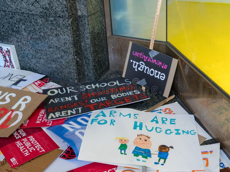 Various discarded signs along wall for the March for Our Lives r royalty free stock photo