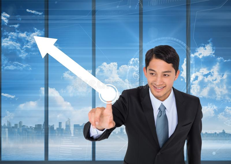 Businessman pointing at arrow. Digital composite of businessman pointing at arrow royalty free stock images
