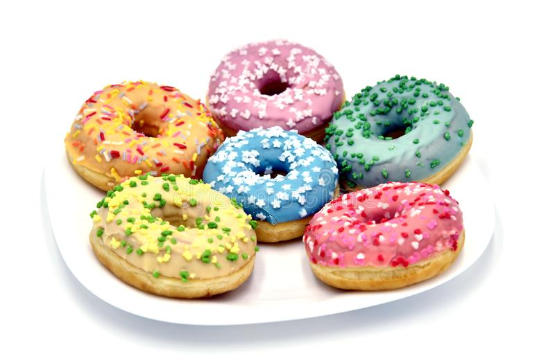 Donuts. Various donuts. Pile of assorted donuts isolated on white background. Various donuts on white background. Close up of a selection of colorful donuts royalty free stock photography