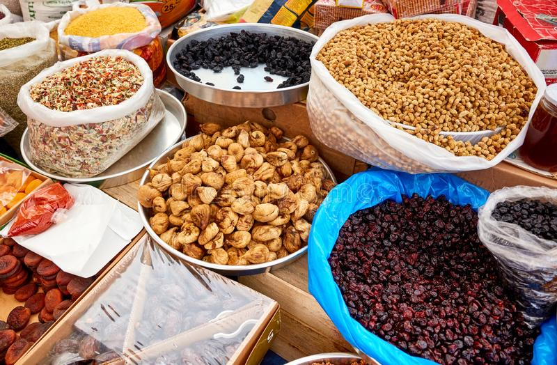 Various dried fruits in an authentic bazaar. Dried fig, dry prune, mulberry, dry prune, and dried apricots in an authentic Turkish bazaar royalty free stock photo