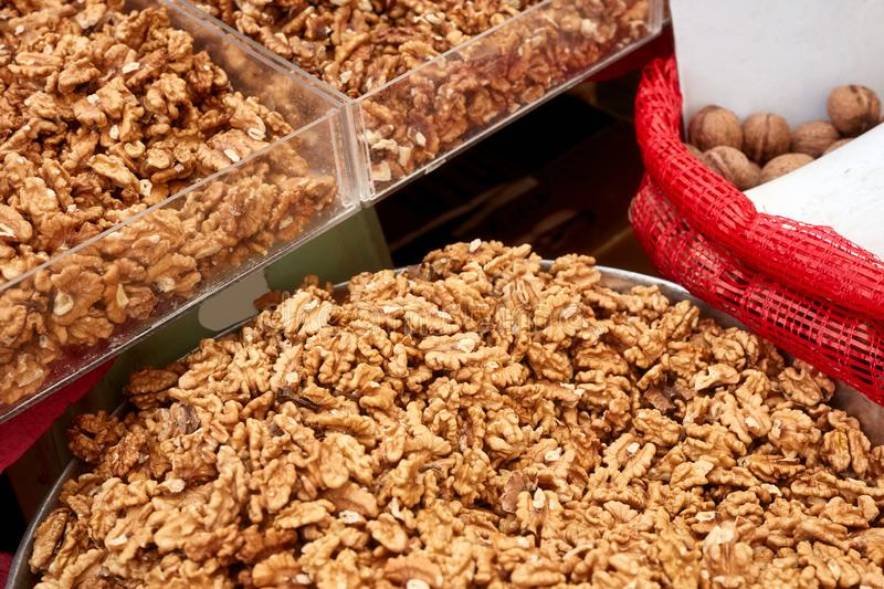 Various dried fruits in an authentic bazaar. Pile of walnut kernel in an authentic bazaar stock photos