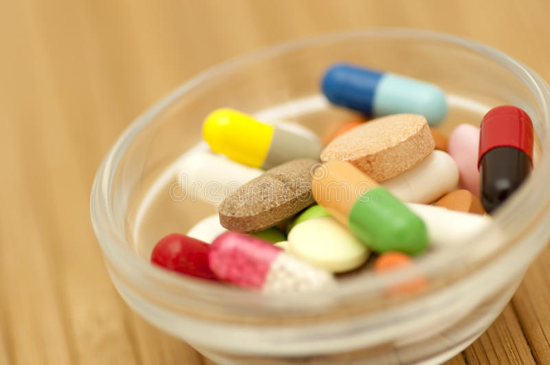 Various drugs in small salad bowl stock photos
