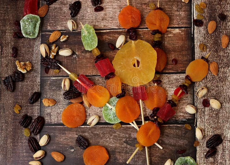 Colorful dried fruits for the Jewish holiday of Tu Bishvat. Various dry fruits on a wooden table background for the Jewish holiday of Tu BiShvat royalty free stock photo